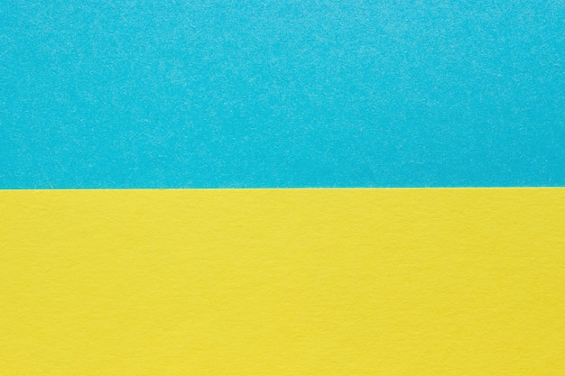 Abstrakcjonistyczny błękit, koloru żółtego papierowy tło, tekstury carbord