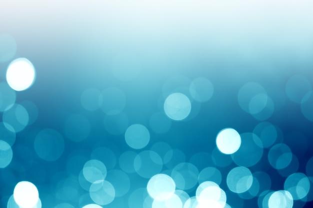 Abstrakcjonistyczny błękita światła bokeh tło