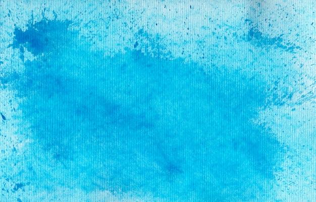 Abstrakcjonistyczny błękitny akwareli tło - pluśnięcia i kleksy