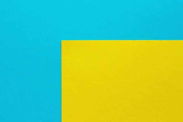 Abstrakcjonistyczny błękitny, żółty papierowy tło, tekstury carbord
