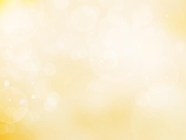 Abstrakcjonistyczny bokeh tła koloru złoto