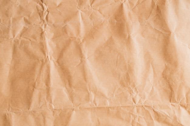 Abstrakcjonistyczny brąz przetwarza zmiętego papier dla tła, zagniecenie brown papierowe tekstury dla projekta