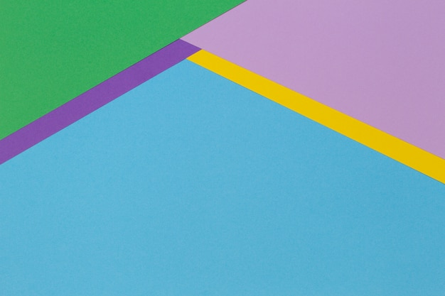 Abstrakcjonistyczny geometryczny papier transparent tło z modnym jasnoniebieskim, żółtym, różowym, fioletowym papierem tekstury tła