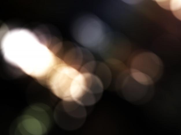 Abstrakcjonistyczny miękki bokeh na czarnym koloru tle.