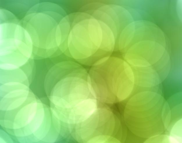 Abstrakcjonistyczny miękki bokeh na zielonego koloru tle.