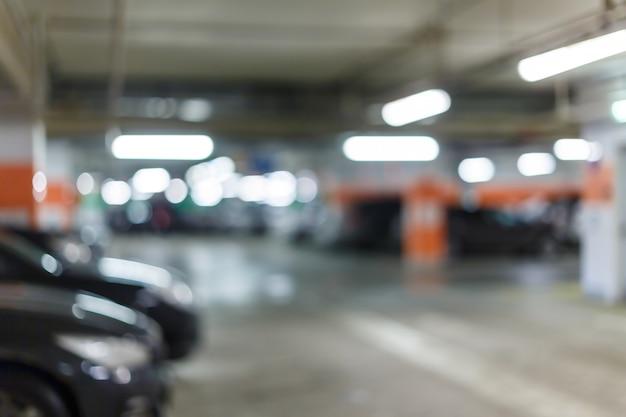 Abstrakcjonistyczny plamy bokeh tło podziemny parking