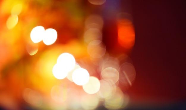 Abstrakcjonistyczny plamy bokeh tło z światłem - pomarańcze i czerwień