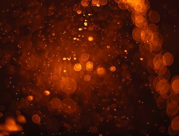 Abstrakcjonistyczny pomarańczowy grunge bożych narodzeń tło. świąteczny elegancki abstrakcjonistyczny tło z bokeh światłami.