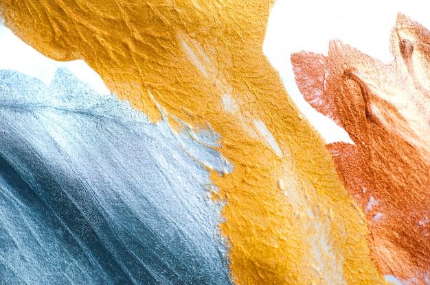 Abstrakcjonistyczny tło malujący z muśnięciem złota i srebra farba
