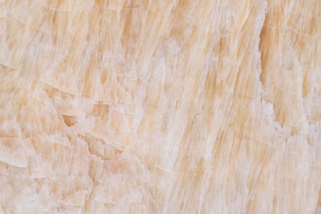 Abstrakcjonistyczny tło od marmurowej tekstury powierzchni na ścianie.