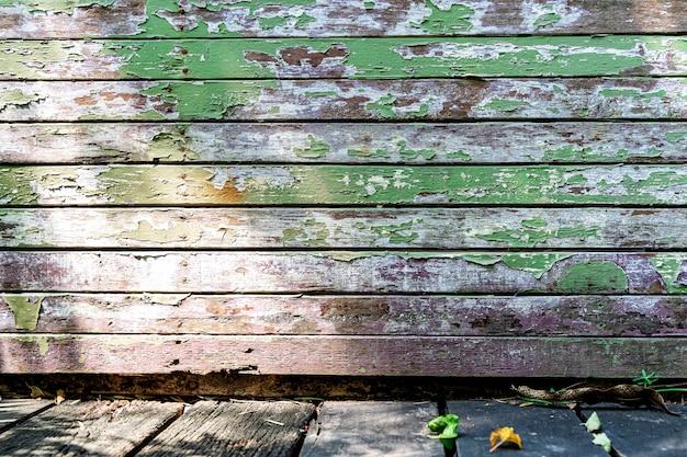 Abstrakcjonistyczny tło od starego zielonego drewnianego deski wzoru na ścianie z grunge i światłem słonecznym.