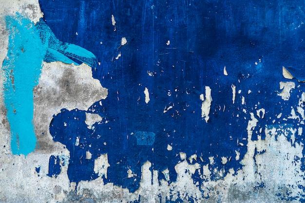 Abstrakcjonistyczny tło od starej błękitnej betonowej ściany z grunge i drapał. tło retro i vintage.