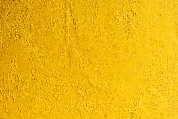 Abstrakcjonistyczny tło od złotej ściany tekstury z światłem słonecznym. luksusowe i eleganckie tapety.