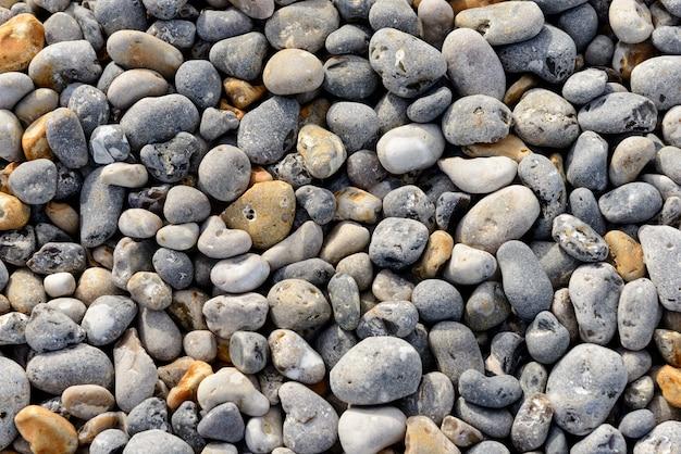Abstrakcjonistyczny tło z otoczakami - round morze kamienie