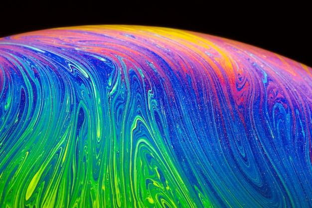Abstrakcjonistyczny tło z zieloną i purpurową sferą