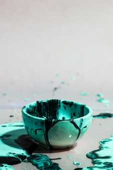 Abstrakcjonistyczny tło z zielonym farby pluśnięciem