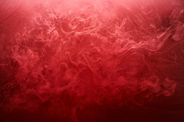 Abstrakcyjne czerwone tło oceanu, rubinowe farby w wodzie, żywe, jasne, szkarłatne dymne tapety