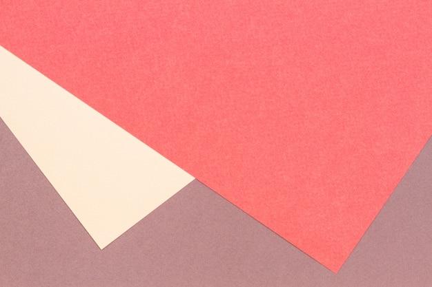 Abstrakcyjne geometryczne tekstury papieru tło kartonowe beżowy brązowy koral żółty pastelowe modne kolory