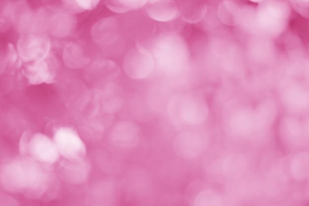 Abstrakcyjne jasnoróżowe tło z pięknym efektem bokeh jest idealne na tło dnia miłości