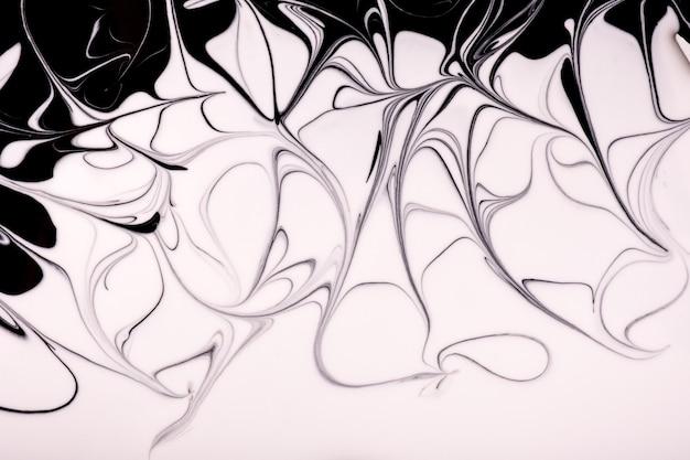 Abstrakcyjne kolory tła sztuki płynnej czerni i bieli.
