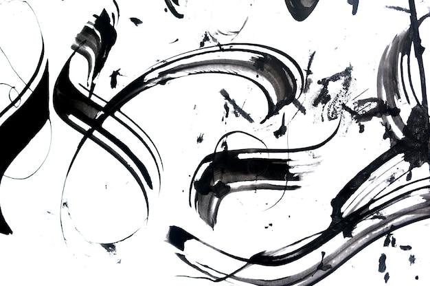 Abstrakcyjne pociągnięcia pędzlem i plamy farby na papierze