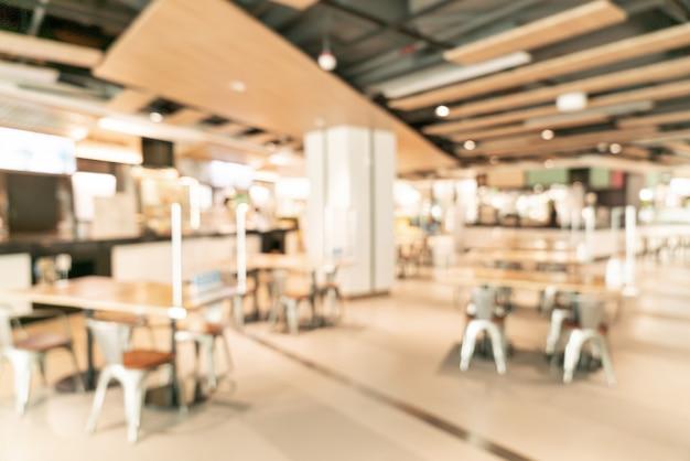 Abstrakcyjne rozmycie food court w centrum handlowym na tle