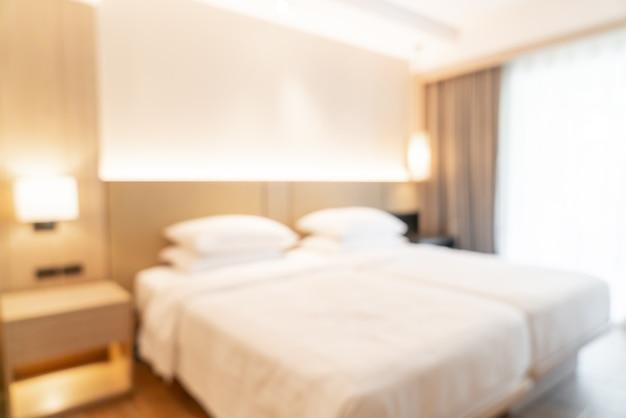 Abstrakcyjne rozmycie i niewyraźna sypialnia w ośrodku hotelowym na tle