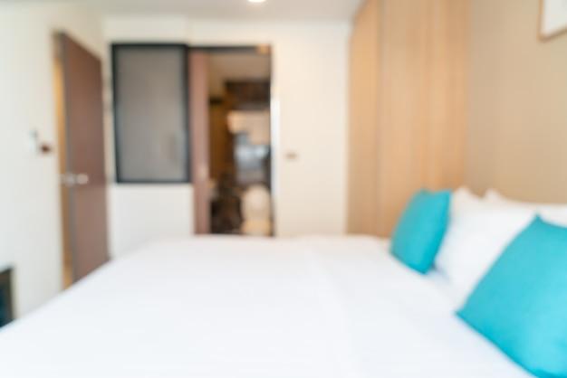 Abstrakcyjne rozmycie łóżka w sypialni na tle