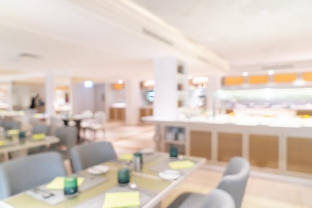 Abstrakcyjne rozmycie restauracji hotelowej na tle