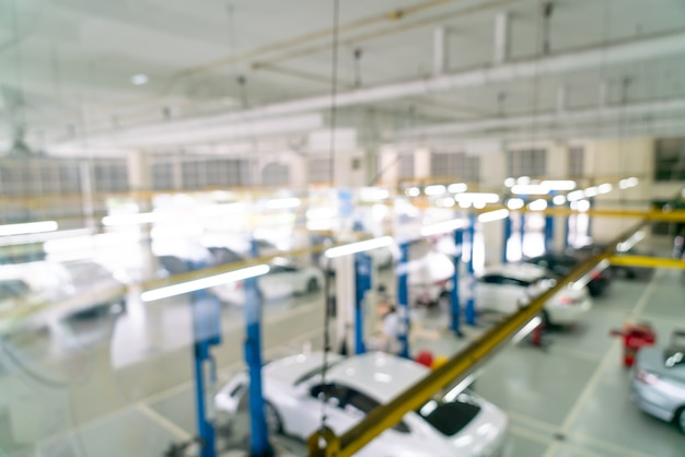 Abstrakcyjne rozmycie samochodów garażowych na tle