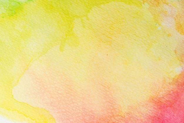 Abstrakcyjne tło akwarela zielony, żółty, pomarańczowy i czerwona róża. farba do malowania ręcznego