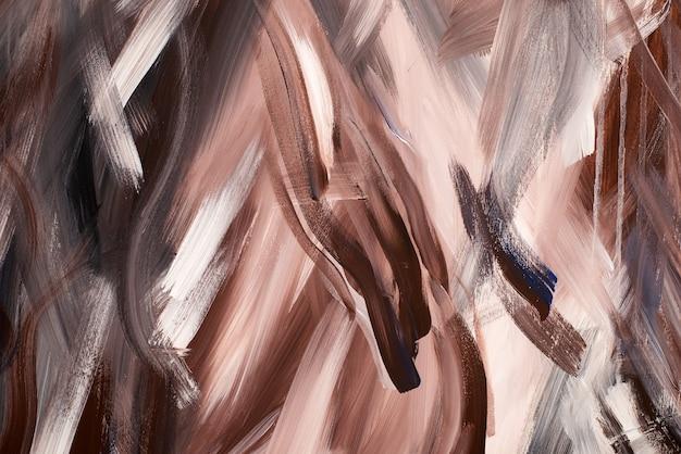 Abstrakcyjne tło chaotycznie rozmazane farbą akrylową. wizerunek ciemnobrązowych, beżowych, czarnych i czarnych pociągnięć pędzla z fakturą mokrego stiuku.