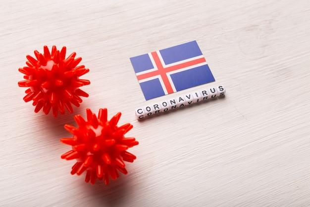 Abstrakcyjny model szczepu wirusa koronawirusa zespołu oddechowego na bliskim wschodzie 2019-ncov lub koronawirusa covid-19 z tekstem i flagą islandii na białym tle