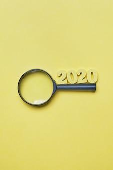 Abstrakt 2020 drewniane postacie i powiększać - szklany tło
