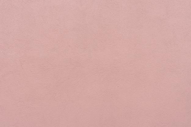 Abstrakt betonowej ściany różowy tło