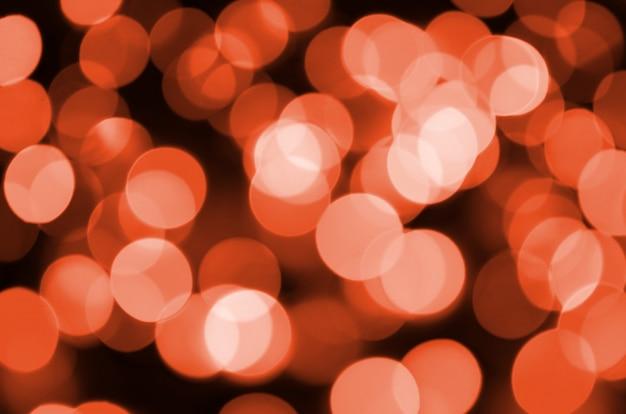 Abstrakt zamazujący czerwona błyszcząca połysk żarówek świateł tło