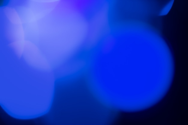 Abstrakta zamazany tło z błękitnymi światłami