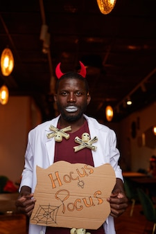 African man at halloween party