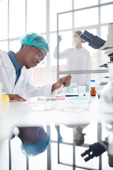 African med school student in laboratory
