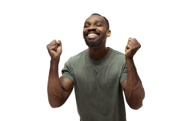 Afrykański mężczyzna na białym tle, meme emocje, śmieszne