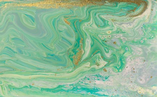 Agatowy wzór w zielone i złote fale. ocean styl piękne tło.