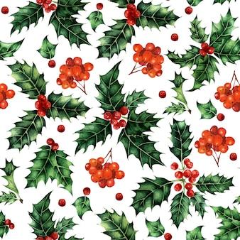 Akwarela bezszwowe wzór z liśćmi ostrokrzewu i świątecznym wzorem jagód jarzębiny na boże narodzenie