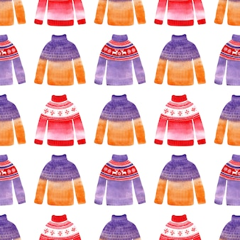 Akwarela bezszwowe wzór z zimowe swetry, czapki i rękawiczki.