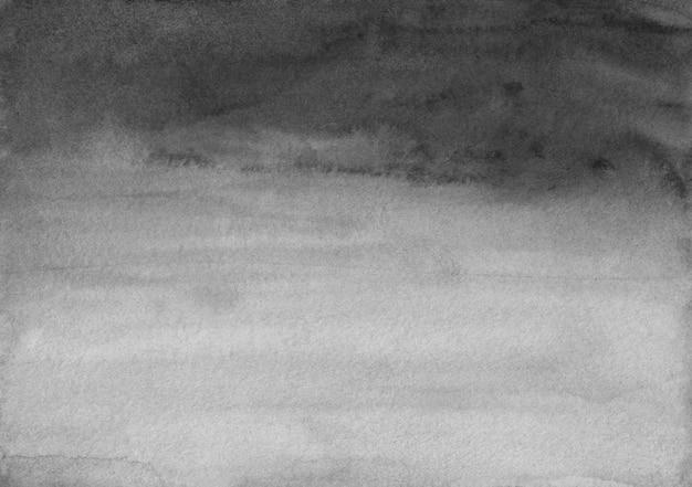 Akwarela czarne i szare tło tekstura. pociągnięcia pędzlem na papierze.
