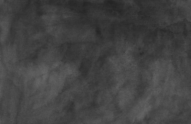 Akwarela czarne i szare tło tekstura ręcznie malowane. kolor wody streszczenie stary monochromatyczne nakładki. plamy atramentu na papierze.