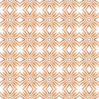 Akwarela ikat powtarzające się obramowanie płytek. pomarańczowy efektowny letni szyk boho. tekstylny zniewalający nadruk, tkanina na stroje kąpielowe, tapeta, opakowanie. ikat powtarzający się projekt stroju kąpielowego.