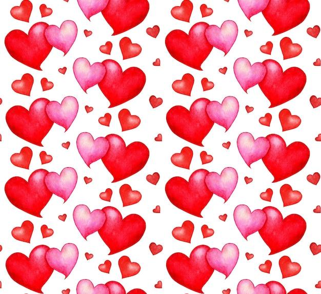 Akwarela ilustracja wzór serca bez szwu. czerwone i różowe serca powtarzają się bez końca. walentynki