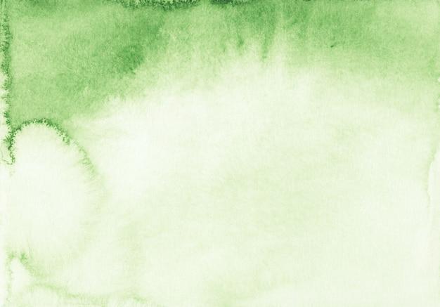 Akwarela jasnozielony i biały tekstura tło gradientowe. aquarelle płynne tło abstrakcyjne. malowane ręcznie