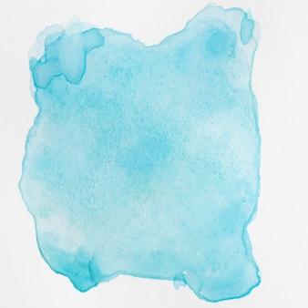 Akwarela płyn niebieski rozprysków na białym tle