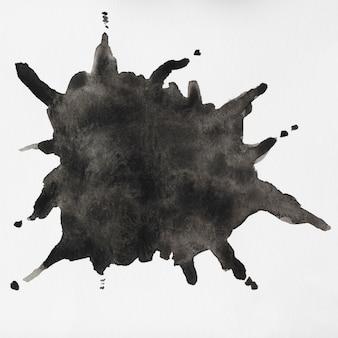 Akwarela płynne czarne plamy na białym tle